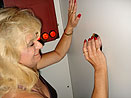nicole in the Gloryhole booth